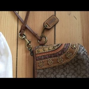Coach wristlet with cute detailing